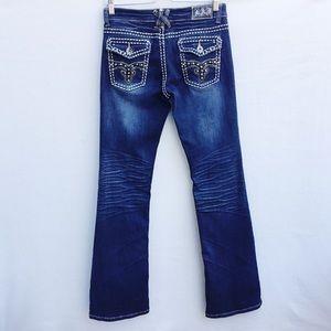 LA Idol studded bootcut jeans.